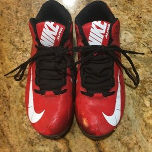 Nike Alpha football cleats, size 8, red and black.